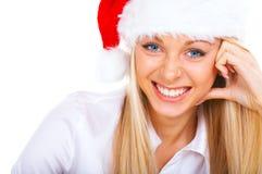 Pretty woman wearing Santa hat stock photos