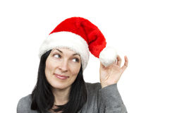 Pretty woman wearing santa hat. Isolated over white Royalty Free Stock Images