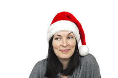 Pretty woman wearing santa hat. Isolated over white Royalty Free Stock Photos