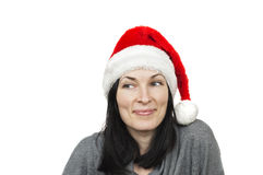 Pretty woman wearing santa hat. Isolated over white Stock Photos