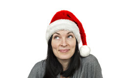 Pretty woman wearing santa hat. Isolated over white Stock Photography
