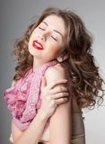 Pretty woman wearing scarf -studio shot on grey background Stock Images