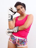 Pretty woman wearing shorts and white boxing gloves Royalty Free Stock Photography