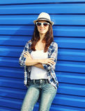 Pretty woman wearing straw hat, sunglasses and checkered shirt Royalty Free Stock Image