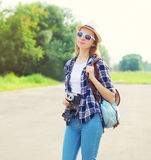 Pretty woman wearing straw hat sunglasses and vintage camera Royalty Free Stock Image