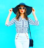 Pretty woman wearing straw hat, white pants Royalty Free Stock Photo
