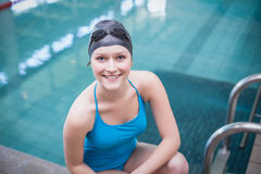 Pretty woman wearing swim cap and swimming goggles. At the pool Royalty Free Stock Images