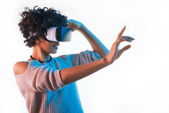 Pretty woman wearing VR goggles touching air Stock Image