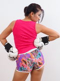 Pretty woman wearing white boxing gloves Stock Images