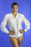 Pretty woman only wearing a white shirt. Stock Images