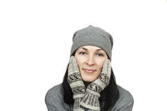 Pretty woman wearing winter hat and mittens. Isolated over white Royalty Free Stock Photos