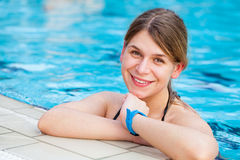 Pretty woman in a wellness pool. Picture of a pretty woman posing in a wellness pool royalty free stock photography