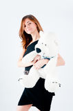 Pretty woman with white bear Royalty Free Stock Image
