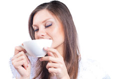 Pretty Woman with white cup eyes closed isolated Royalty Free Stock Photography