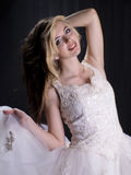 Pretty woman in white dress. Stock Image