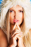 Pretty woman in a white fur hood Royalty Free Stock Images