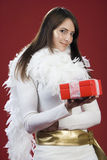 Pretty Woman in White Outfit Holding Red Gift Box Stock Photo