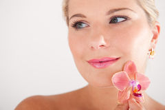 Pretty woman whith pure healthy skin and orchid Stock Photos