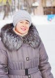 Pretty woman in a winter clothes Stock Photos