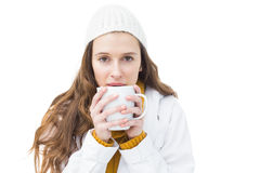 Pretty woman in winter clothes drinking a hot beverage Stock Images