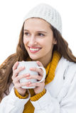 Pretty woman in winter clothes drinking a hot beverage Royalty Free Stock Photography