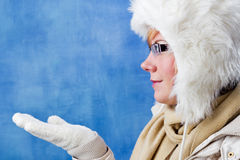 Pretty woman in winter clothing, side view Royalty Free Stock Photo
