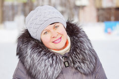 Pretty woman in a winter coat with fur collar Stock Images