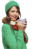 Pretty Woman in Winter Fashion Drinking Coffee Royalty Free Stock Images