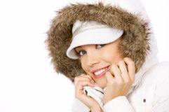Pretty woman in winter fashion. Pretty woman with a lovely warm friendly smile in winter fashion wearing a hooded top trimmed with fur Royalty Free Stock Photo
