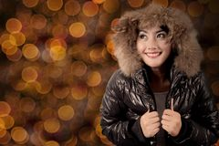 Pretty woman with winter jacket and sparkle light Stock Image