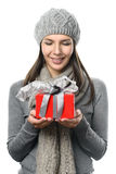 Pretty Woman in Winter Outfit Holding Present Stock Images