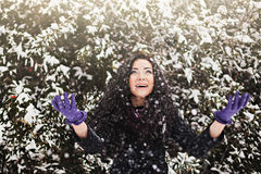 Pretty woman in winter snowy forest Royalty Free Stock Images