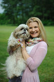 Pretty Woman With Cute Shih Tzu Dog Outdoors Stock Image