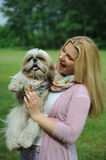 Pretty Woman With Cute Shih Tzu Dog Outdoors Royalty Free Stock Photos