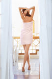 Pretty Woman With Long Legs After Shower Stock Photo