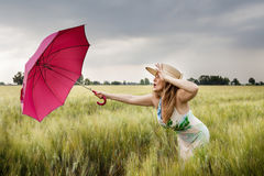 Pretty Woman With Umbrella In A Field Of Wheat Ears Royalty Free Stock Photos