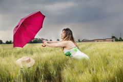 Pretty Woman With Umbrella In A Field Of Wheat Ears Stock Photography