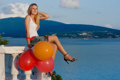 Pretty Woman With Varicoloured Balloons Stock Photography