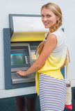 Pretty woman withdrawing money. Royalty Free Stock Photos