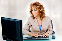 Pretty woman at work Stock Photos