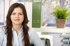 Pretty woman at work royalty free stock photography