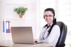 Pretty woman working as operator in office Royalty Free Stock Images