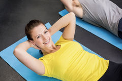 Pretty woman working her abs Royalty Free Stock Images