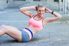 Pretty woman working on her abs Royalty Free Stock Photography