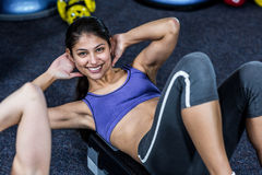 Pretty woman working her abs Stock Images
