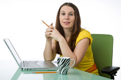 Pretty woman working at her desk Royalty Free Stock Image