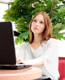 Pretty woman working on her laptop stock images