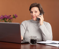 Pretty woman working at home Stock Photo