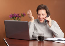 Pretty woman working at home Stock Photos