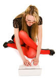 Pretty woman working with laptop on the floor Stock Photography
